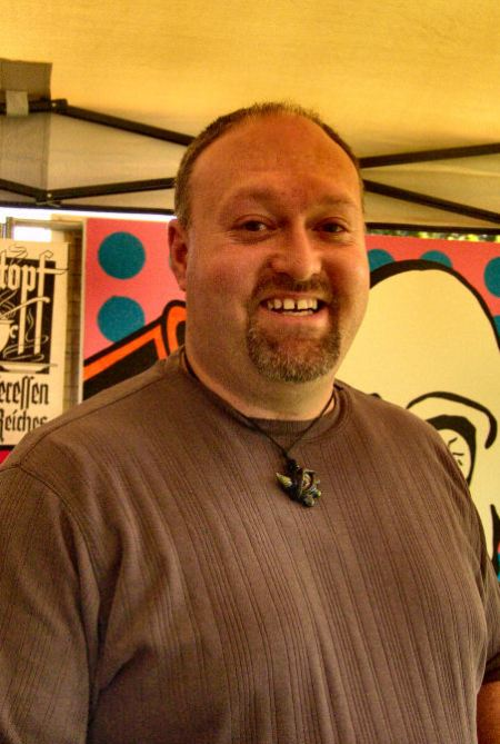 Mike Hurst of Hurst's Handblown Glass at the 2012 North Ogden Art & Food Festival in the Booth of Steve Stones.