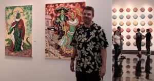 Ogden, Utah artist Steve Stones, stands in front of his works at the 2012 Biennial Weber State University Art Faculty Exhibit.