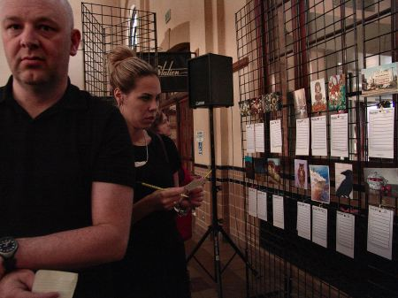 Bidders at the Ogden Union Station's 2012 Secret Art Exhibit, in which Steve Stones participated in